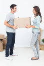 Woman and her husband holding a box in their new house Stock Photos