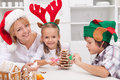 Woman and her kids decorating christmas cookies Stock Photography