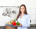 Woman in her kitchen with red and green paprika Royalty Free Stock Photo