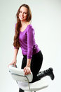 Woman with her knee up on a office chair Royalty Free Stock Photo