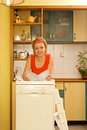 Woman with her new dishwasher Stock Images