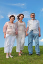 Woman and her parents standing on lawn Royalty Free Stock Image