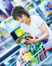 Woman with her purchased grocery items in a cart Royalty Free Stock Images