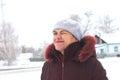 Woman in her 40 s in winter winking