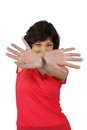 Woman hiding behind her hands brunette in a red top Stock Photography