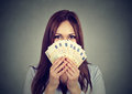 Woman hiding her face behind euro money fan Royalty Free Stock Photo