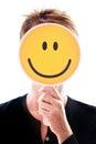 Woman hiding her face behind a smiley an happy Stock Photos