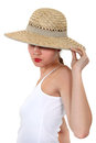 Woman hiding her face under a wide brimmed hat Stock Images