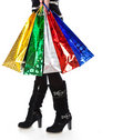A woman in high boots with bright paper bags Royalty Free Stock Photography