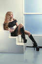 image photo : Woman in high boots in white room