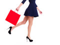 Woman in high heels with red shopping bag standing isolated on white Stock Images