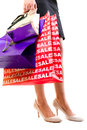 Woman in high heels with shopping bags Royalty Free Stock Photography