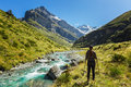 Woman hiker enjoys the view of earnslaw burn track in glenorchy new zealand Stock Image