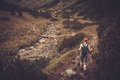 Woman hiker in mountain landscape