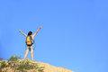 Woman hiker mountain peak young fit asian open arms at Stock Photo