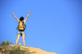Woman hiker mountain peak young fit asian open arms at Royalty Free Stock Images