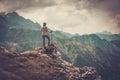 Woman Hiker on a Rock