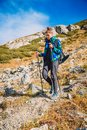 Woman hiker in the mountains. Tourist woman descend from the mountain Royalty Free Stock Photo