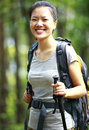 Woman hiker outdoor young asian hiking in nature forest with walking stick Royalty Free Stock Photos
