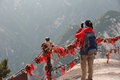 Woman hiker take photo at huashan mountain peak Royalty Free Stock Images