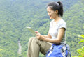 Woman hiker use tablet young asian sit mountain peak Stock Images