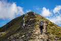 Woman hiker walking on an alpine section of the kepler track one new zealand great walks Royalty Free Stock Photo