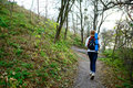 Woman hiker walking the mountain trail in weekend active lifestyle Royalty Free Stock Photography