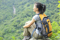 Woman hiker young asian sit mountain peak Stock Image