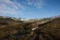 Woman hikes in icelandic landscape Royalty Free Stock Photo