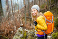 Woman Hiking In Autumn Forest ...