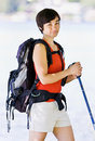 Woman hiking with backpack and walking stick Stock Photos