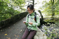 Woman hiking in lake district an east asian reading a map cumbria uk Royalty Free Stock Image