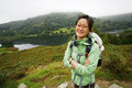 Woman hiking in lake district smiling east asian cumbria uk Royalty Free Stock Images
