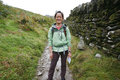 Woman hiking in lake district smiling east asian cumbria uk Stock Photography