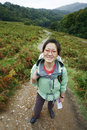 Woman hiking in lake district smiling east asian cumbria uk Stock Photos