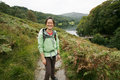 Woman hiking in lake district smiling east asian cumbria uk grasmere the back ground Royalty Free Stock Photography