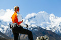Woman hiking in mountains young hiker mount everest national park nepal himalayan nordic walking female looking at beautiful Stock Photography