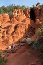 Woman hiking in palo duro a hikes up a steep trail to a cave canyon state park Royalty Free Stock Photo
