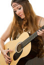 Woman hippie with long hair, playing guitar Royalty Free Stock Image