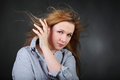 Woman hold hair fluttering in wind Royalty Free Stock Photo