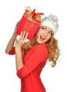 Woman hold red Christmas wrapped gift present smiling Royalty Free Stock Photo