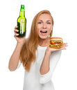 Woman hold tasty unhealthy burger sandwich in hand and bottle of Royalty Free Stock Photo