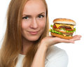 Woman hold tasty unhealthy burger sandwich in hands hungry Royalty Free Stock Photo