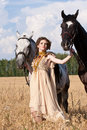 The woman hold two horses Stock Image