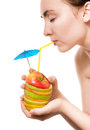 Woman holding apple cocktail Stock Photo