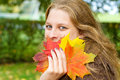Woman holding autumn leaves holdung colorful in the hand Royalty Free Stock Images