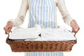 Woman holding a basket of clothes Royalty Free Stock Photos