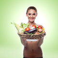 Woman holding basket with vegetable concept vegetarian dieting happy young healthy food Royalty Free Stock Image