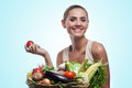 Woman holding basket with vegetable concept vegetarian dieting happy young healthy food Stock Images
