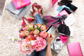 Woman holding a beautiful flower bucket closeup of of peonies and credit card Royalty Free Stock Image